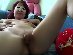 Worthless redhead surprises us on touching a indifferent masturbation video in sexy mask