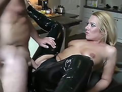 Excellent blonde babe in sexy black latex pants is having an awesome cock shoved inside of her small mouth and then is fucking her right in her asshole.