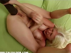 Jada stretching both her holes with monster dildos