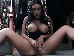 Megan Jones with massive boobs strips to give a close-up view of her cunt in solo scene