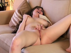 Shaved slit Jessie does some finger fucking on her honey pot